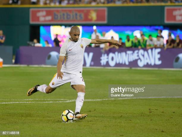 Bruno Peres of AS Roma kicks a penalty shot during overtime of a match against Paris SaintGermain during the second half at Comerica Park on July 19...