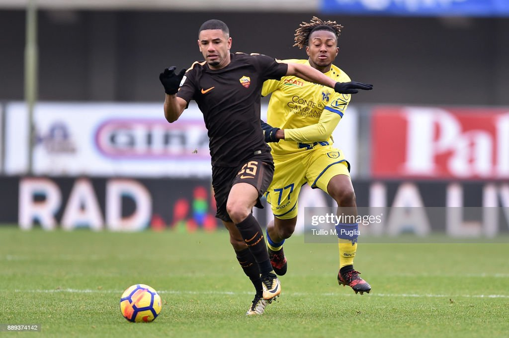 Bruno Peres (L) of Roma and Samuel Bastien of Chievo Verona compete for the ball during the Serie A match between AC Chievo Verona and AS Roma at Stadio Marc'Antonio Bentegodi on December 10, 2017 in Verona, Italy.