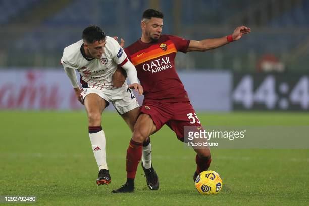Bruno Peres of Roma is challenged by Gabriele Zappa of Cagliari during the Serie A match between AS Roma and Cagliari Calcio at Stadio Olimpico on...