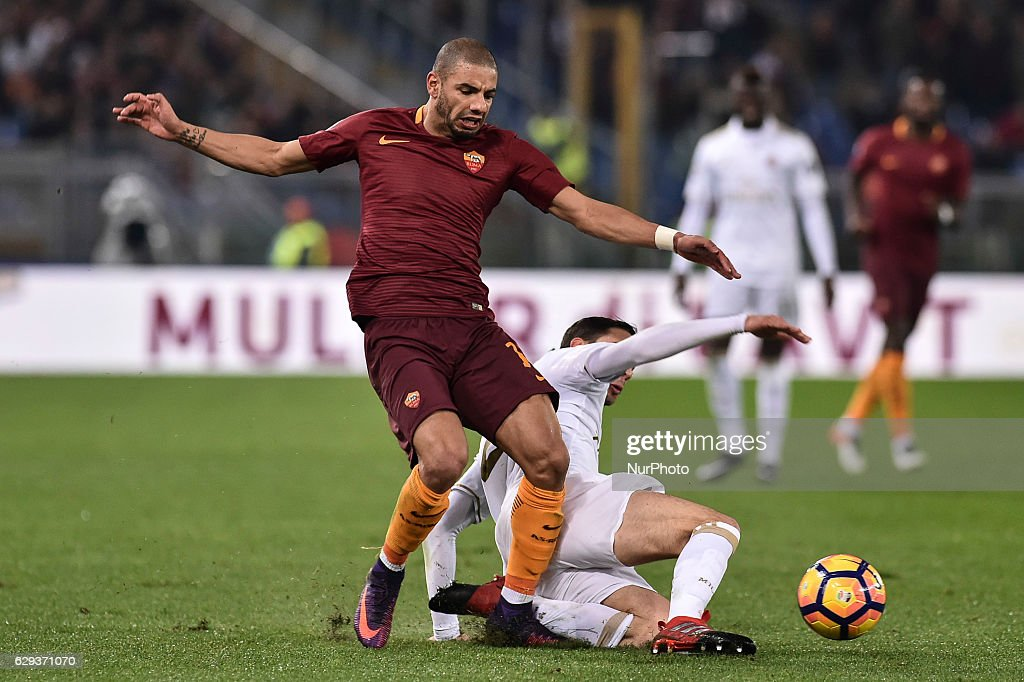 Bruno Peres of Roma is challenged by Mattia De Sciglio of AC Milan during the Serie A match between Roma v Milan on December 12, 2016 in Rome, Italy.