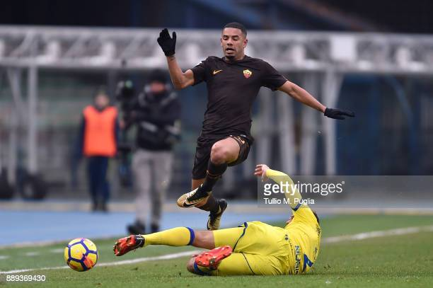 Bruno Peres of Roma jumps as Pawel Jaroszynski of Chievo Verona tackles during the Serie A match between AC Chievo Verona and AS Roma at Stadio...