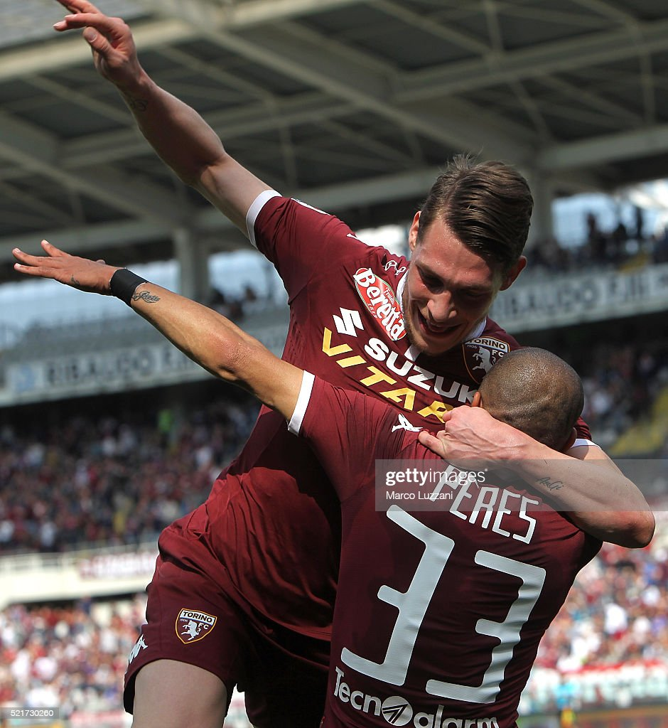 Bruno Peres #33 of Torino FC celebrates with his team-mate Andrea Belotti after scoring the opening goal during the Serie A match between Torino FC and Atalanta BC at Stadio Olimpico di Torino on April 10, 2016 in Turin, Italy.