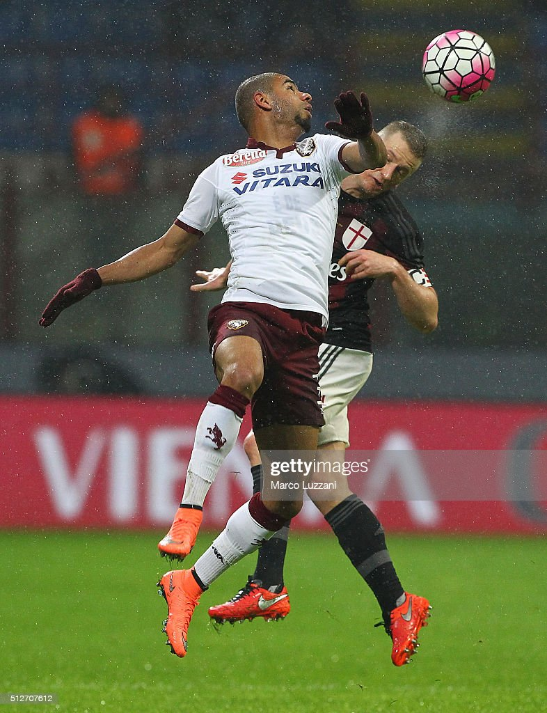 Bruno Peres of Torino FC competes for the ball with Ignazio Abate (back) of AC Milan during the Serie A match between AC Milan and Torino FC at Stadio Giuseppe Meazza on February 27, 2016 in Milan, Italy.