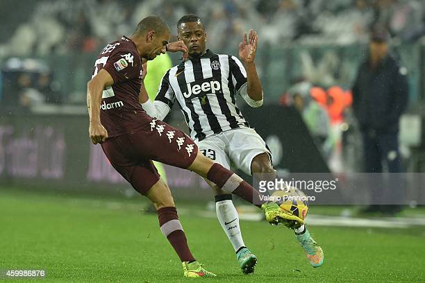 Bruno Peres of Torino FC in action against Patrice Evra of Juventus FC during the Serie A match between Juventus FC and Torino FC at Juventus Arena...