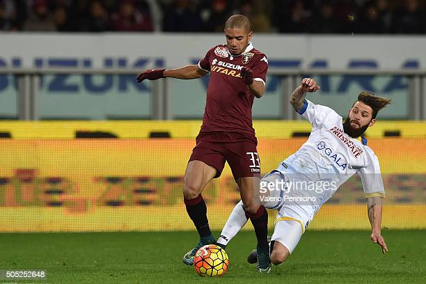 Bruno Peres of Torino FC is tackled by Oliver Gragl of Frosinone Calcio during the Serie A match between Torino FC and Frosinone Calcio at Stadio...