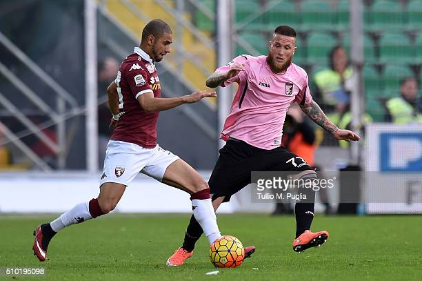 Bruno Peres of Torino is challenged by Michel Morganella of Palermo Moretti of Torino compete for the ball during the Serie A match between US Citta...