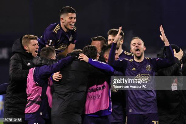Bruno Petkovic of GNK Dinamo Zagreb celebrates victory with team mates following the UEFA Europa League Round of 16 Second Leg match between Dinamo...