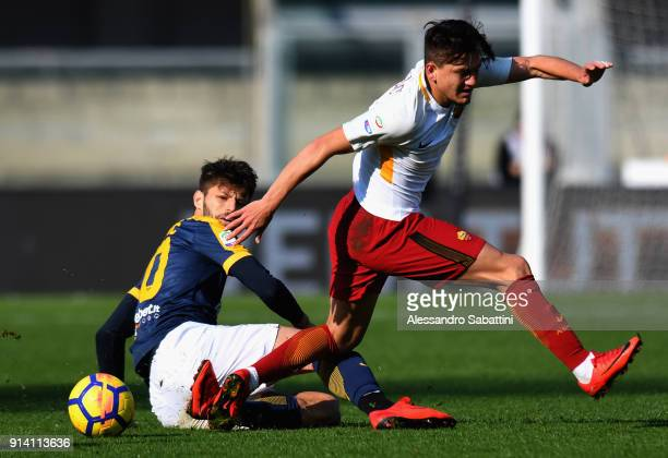 Bruno Petkovic of Hellas Verona competes for the ball whit Cengiz Under of AS Roma during the serie A match between Hellas Verona FC and AS Roma at...