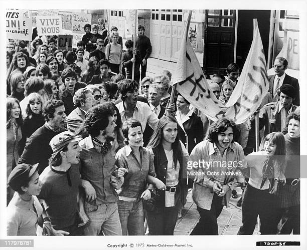 Bruno Pradal Annie Girardot and Nathalie Nell lead fellow teachers and students in a scene from the film 'To Die of Love' aka 'Mouir d'aimer' 1972