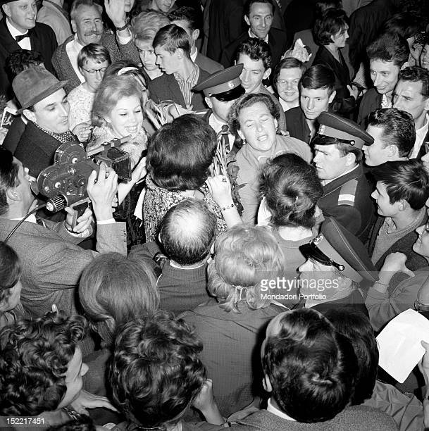 Bruno Prevedi Fiorenza Cossotto Mirella Freni and Margherita Wallman surrounded by spectators outside the theatre at the end of the performance of...