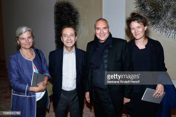 Bruno Racine with wife Beatrice and Dominique Perrault with his wife Gaelle attend the Kering Heritage Days Opening Night at 40 Rue de Sevres on...