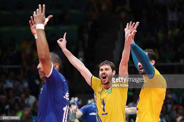 Bruno Rezende and Luiz Felipe Marques Fonteles of Brazil celebrate during the Men's Gold Medal Match between Italy and Brazil on Day 16 of the Rio...