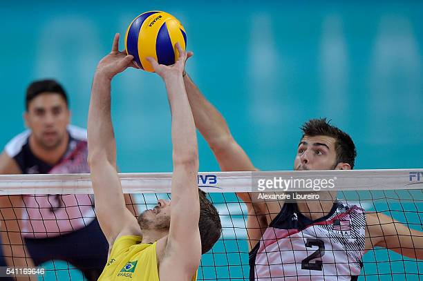 Bruno Rezende of Brazil in action as Aaron Russell of USA attempts to block during the match between Brasil and USA on the FIVB World League 2016 Day...