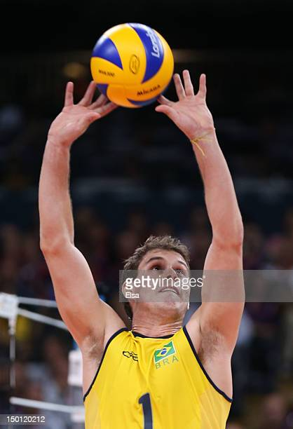 Bruno Rezende of Brazil sets a volley against Italy during the Men's Volleyball Semifinals on Day 14 of the London 2012 Olympic Games at Earls Court...