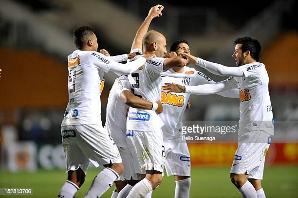 Bruno Rodrigo of Santos celebrates a scored goal with his teammates during a match between Santos and Universidad de Chile as part of the Recopa...