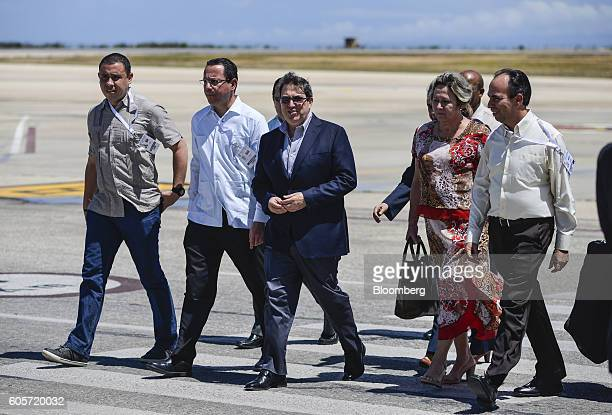 Bruno Rodriguez Parrilla, Cuba's minister of foreign affairs, center, arrives at the Santiago Marino Caribbean International Airport for the...