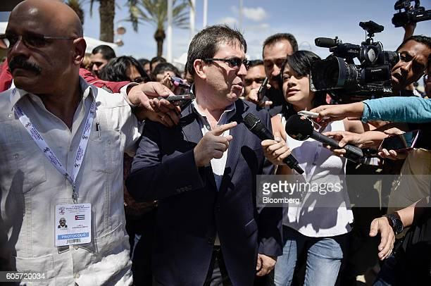 Bruno Rodriguez Parrilla, Cuba's minister of foreign affairs, center, speaks to members of the media while arriving at the Santiago Marino Caribbean...