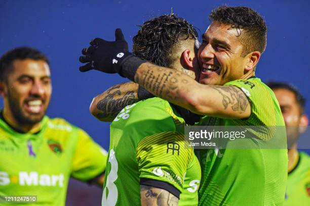 Bruno Romo and Angelo Sagal of Juarez celebrates after scoring the first goal of his team during the 9th round match between FC Juarez and Leon as...