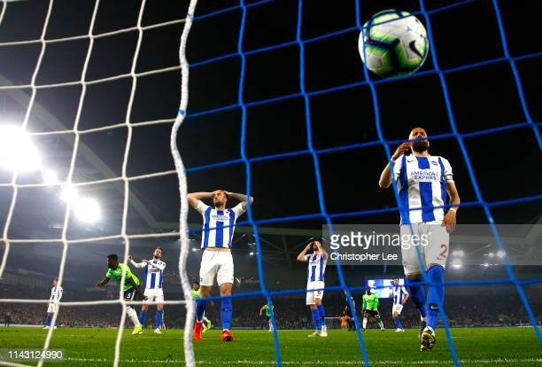 Bruno Saltor Grau of Brighton and Hove Albion and Shane Duffy of Brighton and Hove Albion react to Cardiff City scoring there second goal during the...