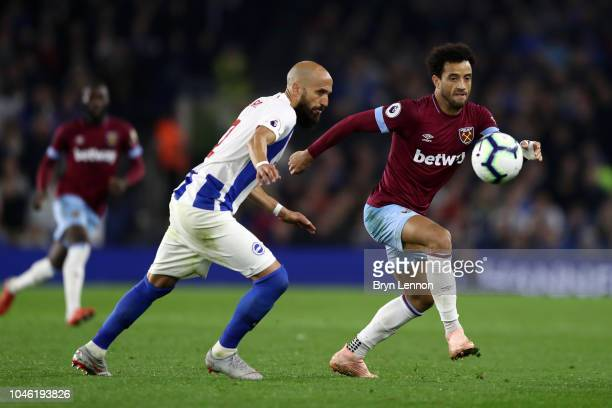 Bruno Saltor Grau of Brighton and Hove Albion battles for possession with Felipe Anderson of West Ham United during the Premier League match between...