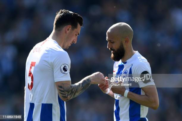 Bruno Saltor Grau of Brighton and Hove Albion gives the captain's armband to Lewis Dunk of Brighton and Hove Albion as he is substituted during the...
