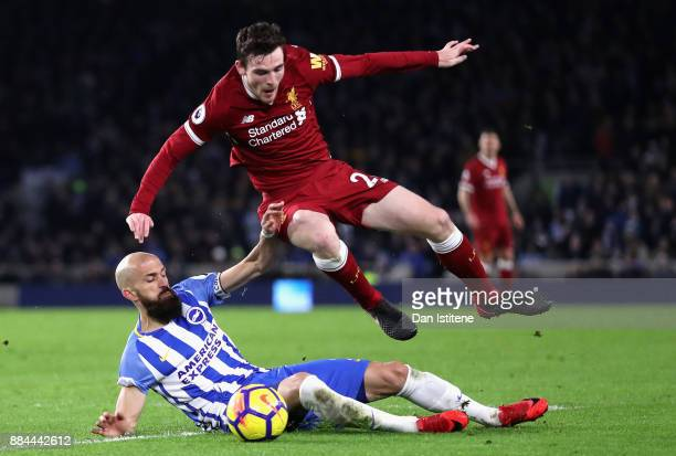 Bruno Saltor of Brighton and Hove Albion tackles Andy Robertson of Liverpool during the Premier League match between Brighton and Hove Albion and...