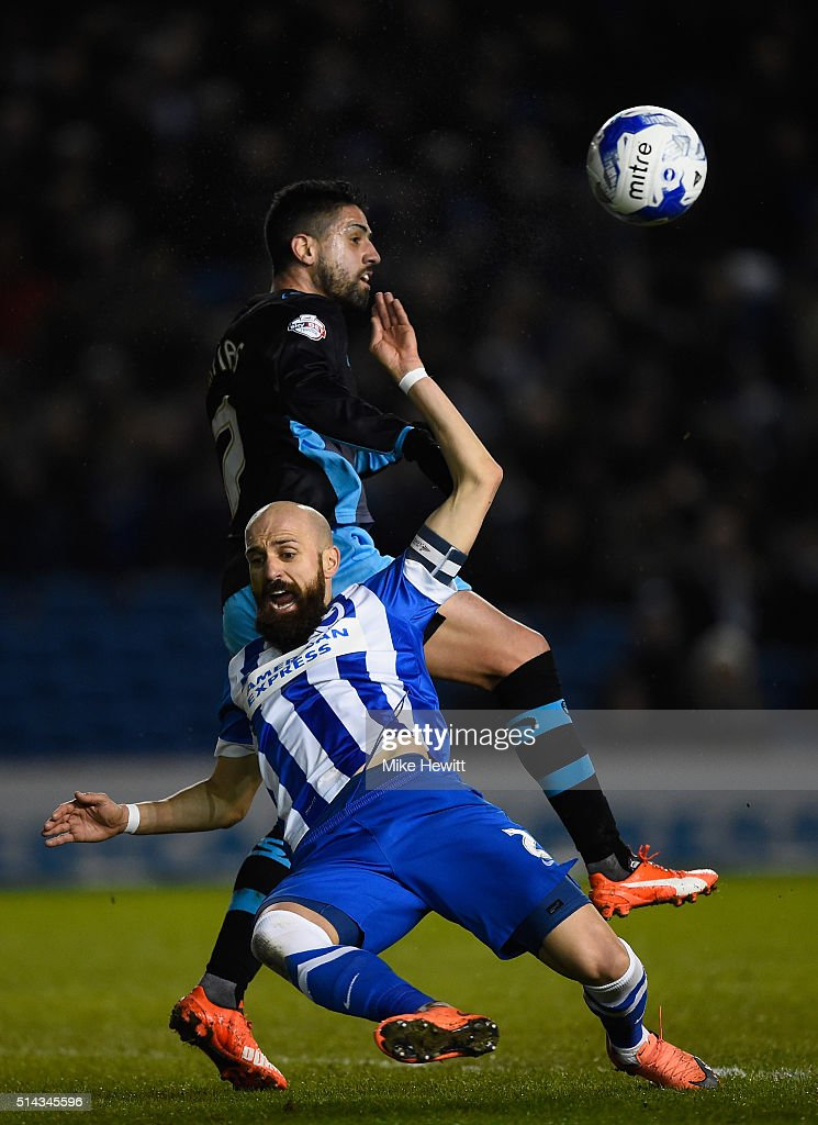 Bruno Saltor of Brighton & Hove Albion is challenged by Marco Matias of Sheffield Wednesday during the Sky Bet Championship match between Brighton and Hove Albion and Sheffield Wednesday at the Amex Stadium on March 8, 2016 in Brighton, United Kingdom.