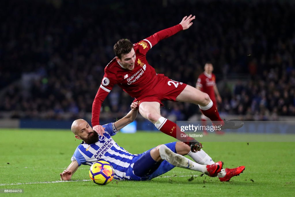 Bruno Saltor of Brighton & Hove Albion tackles Andrew Robertson of Liverpool during the Premier League match between Brighton and Hove Albion and Liverpool at Amex Stadium on December 2, 2017 in Brighton, England.