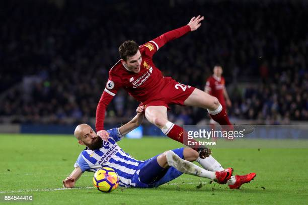 Bruno Saltor of Brighton Hove Albion tackles Andrew Robertson of Liverpool during the Premier League match between Brighton and Hove Albion and...