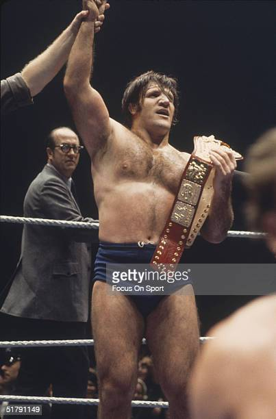 Bruno Sammartino a professional wrestler has his hand raised by the referee in victory. Sammartino held the World Wrestling Federation Championship...