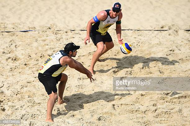 Bruno Schmidt and Alison Cerutti in action during a beach volleyball match in the Banco do Brasil Beach Volleyball Open at Icarai beach on September...