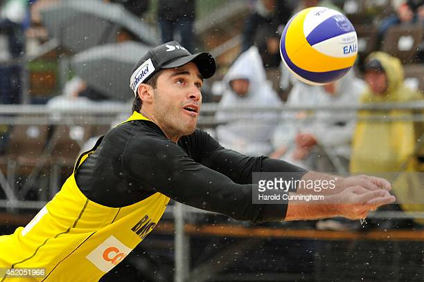 Bruno Schmidt of Brazil defends during the men main draw match AlisonBruno v GibbPatterson as part of the fourth day of the FIVB Gstaad Grand Slam on...