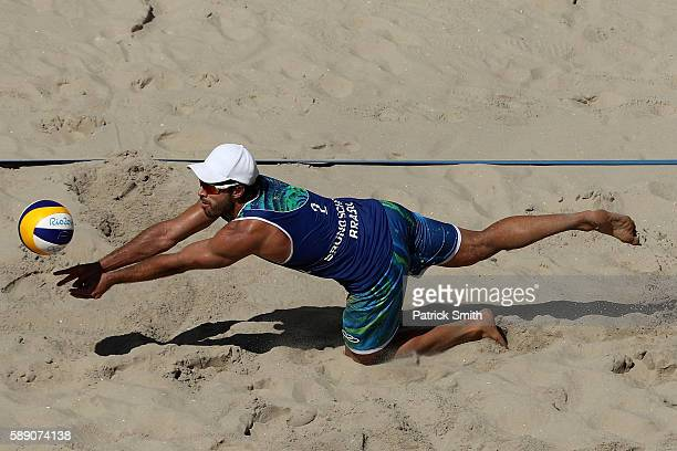 Bruno Schmidt Oscar of Brazil dives for the ball during a Men's Round of 16 match between Spain and Brazil on Day 8 of the Rio 2016 Olympic Games at...