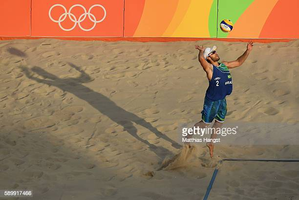 Bruno Schmidt Oscar of Brazil serves during the Men's Beach Volleyball Quarterfinal match between the United States and Brazil on Day 10 of the Rio...