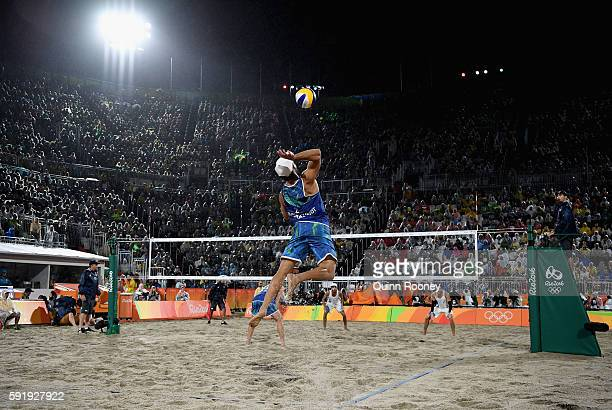 Bruno Schmidt Oscar of Brazil serves the ball during the Men's Beach Volleyball Gold medal match against Paolo Nicolai and Daniele Lupo of Italy at...