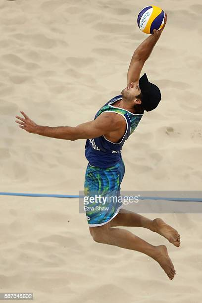 Bruno Schmidt Oscar of Brazil spikes during the Men's Beach Volleyball preliminary round Pool A match on Day 3 of the Rio 2016 Olympic Games at the...