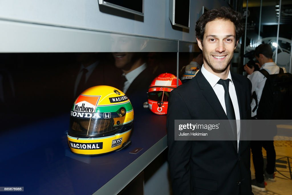 Bruno Senna (Ayrton Senna nephew) is pictured with his uncle helmet during the FIA Hall of Fame Induction ceremony at Automobile Club De France on December 4, 2017 in Paris, France.