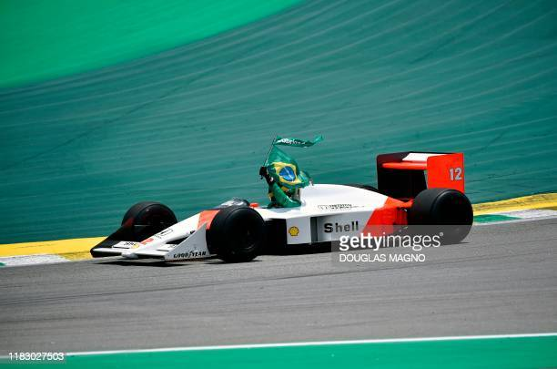 Bruno Senna the nephew of the late Brazilian driver Ayrton Senna powers the latter's McLaren during a tribute before the start of the F1 Brazil Grand...