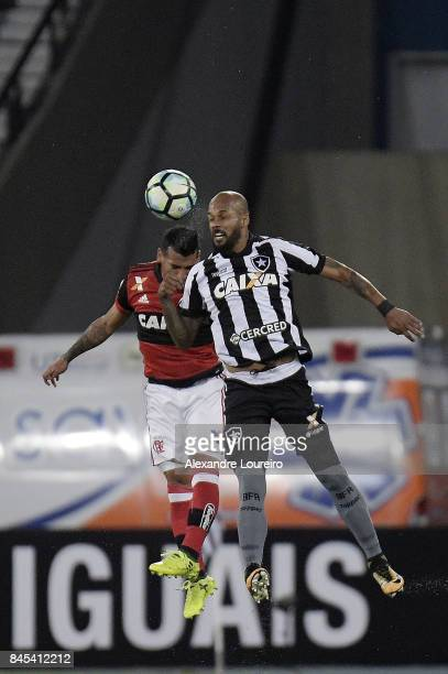 Bruno silva of Botafogo battles for the ball with Miguel Trauco and Geuvânio of Flamengo during the match between Botafogo and Flamengo as part of...