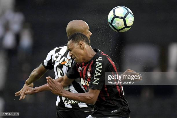Bruno Silva of Botafogo struggles for the ball with Fabrício of Atletico PR during the match between Botafogo and Atletico PR as part of Brasileirao...