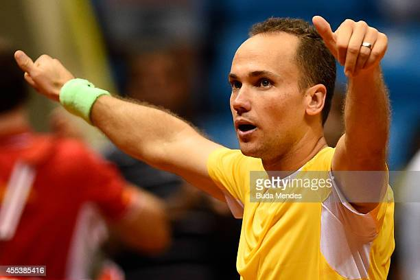 Bruno Soares of Brazil acknowledges the fans after defeating Marc Lopez and David Marrero of Spain in his playoff doubles match with teammate Marcelo...