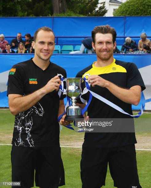 Bruno Soares of Brazil and Alexander Peya of Austria pose with the trophy after their victory in the men's doubles final against Colin Fleming and...