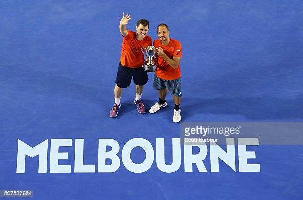 Bruno Soares of Brazil and Jamie Murray of Great Britain pose with the trophy after winning the Men's Doubles Final match against Daniel Nestor of...
