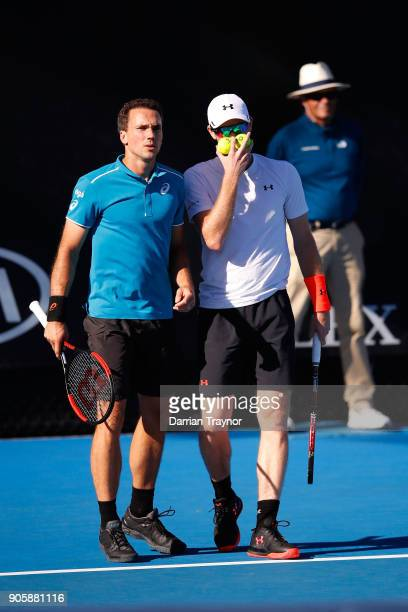Bruno Soares of Brazil and Jamie Murray of Great Britain talk tactics in their first round men's doubles match against Frances Tiafoe of the United...