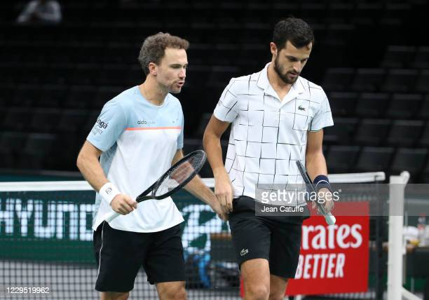 Bruno Soares of Brazil and Mate Pavic of Croatia talk during the doubles semifinal on day 6 of the Rolex Paris Masters, an ATP Masters 1000...
