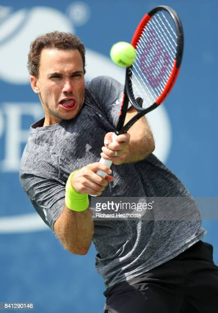 Bruno Soares of Brazil returns a shot against Julian Knowle and Alexander Peya of Austria during their first round Men's Doubles match on Day Four of...