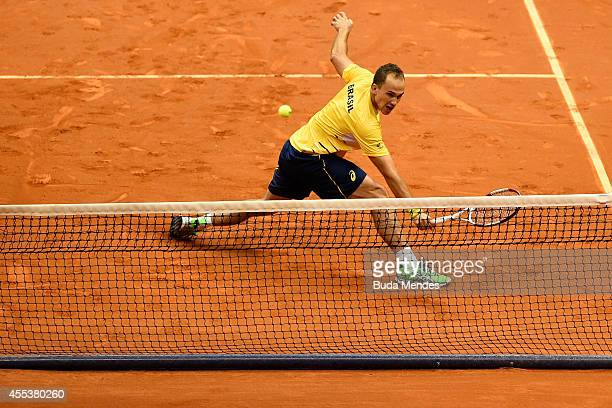 Bruno Soares of Brazil returns a shot during his playoff doubles match against Marc Lopez and David Marrero of Spain on Day Two of the Davis Cup at...