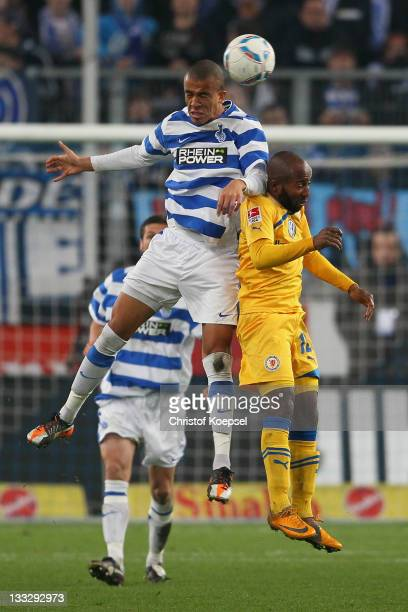 Bruno Soares of Duisburg and Dominick Kumbela of Braunschweig go up for a header during the Second Bundesliga match between MSV Duisburg and...
