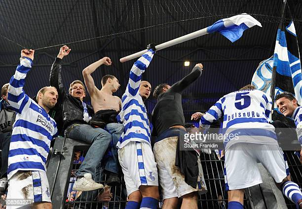 Bruno Soares of Duisburg celebrates with fans as he waves a corner flag at the end of the DFB Cup quarter final match between MSV Duisburg and 1 FC...
