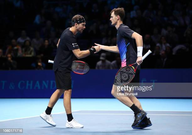 Bruno Soares of South Africa and Jamie Murray of Great Britain react during their match against Michael Venus of New Zealand and Raven Klaasen of...